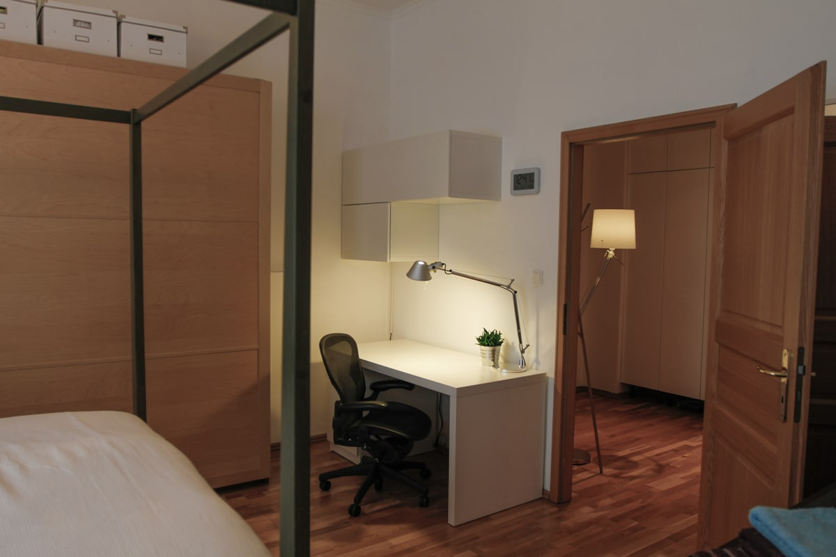 Master bedroom to desk area with Aeron chair and Tolomeo desk lamp