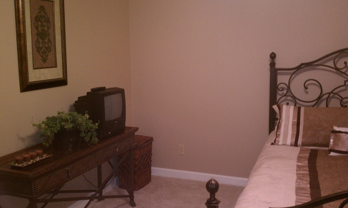 Another view of a bedroom