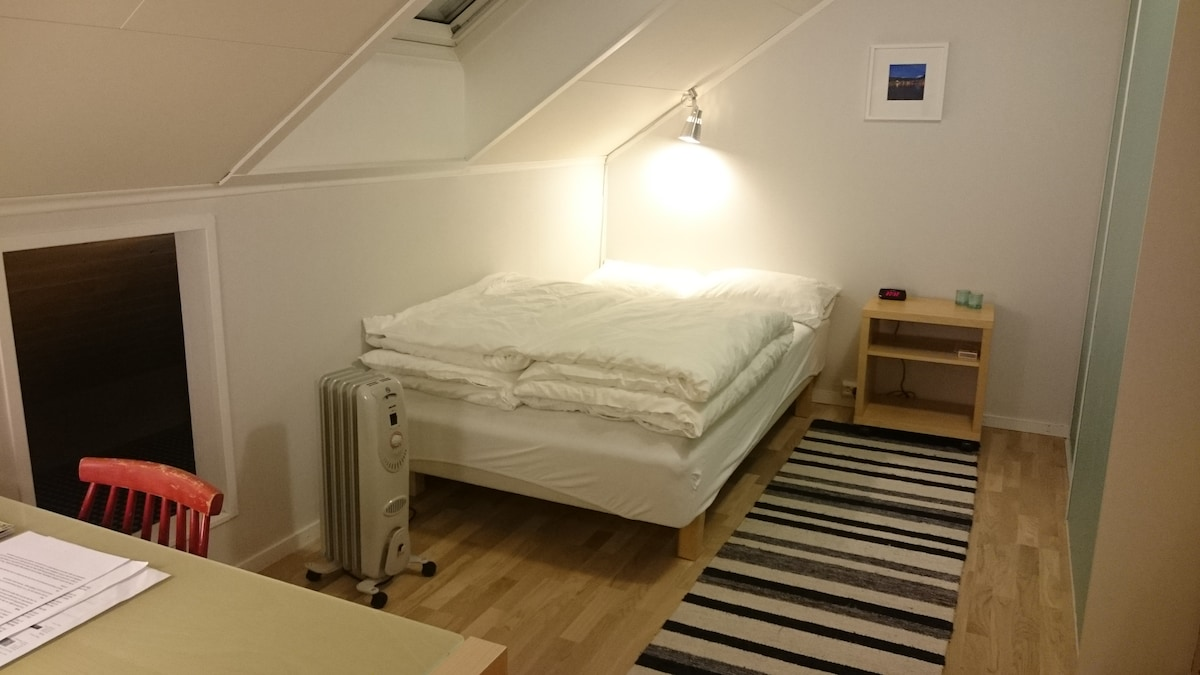 The bedroom, with the bed made for two persons.