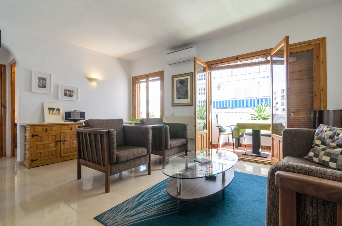 Living room/dining room - contemporary furniture, recently re-tiled, contemporary artwork, air conditioning & heating, TV, music  player with IPad dock