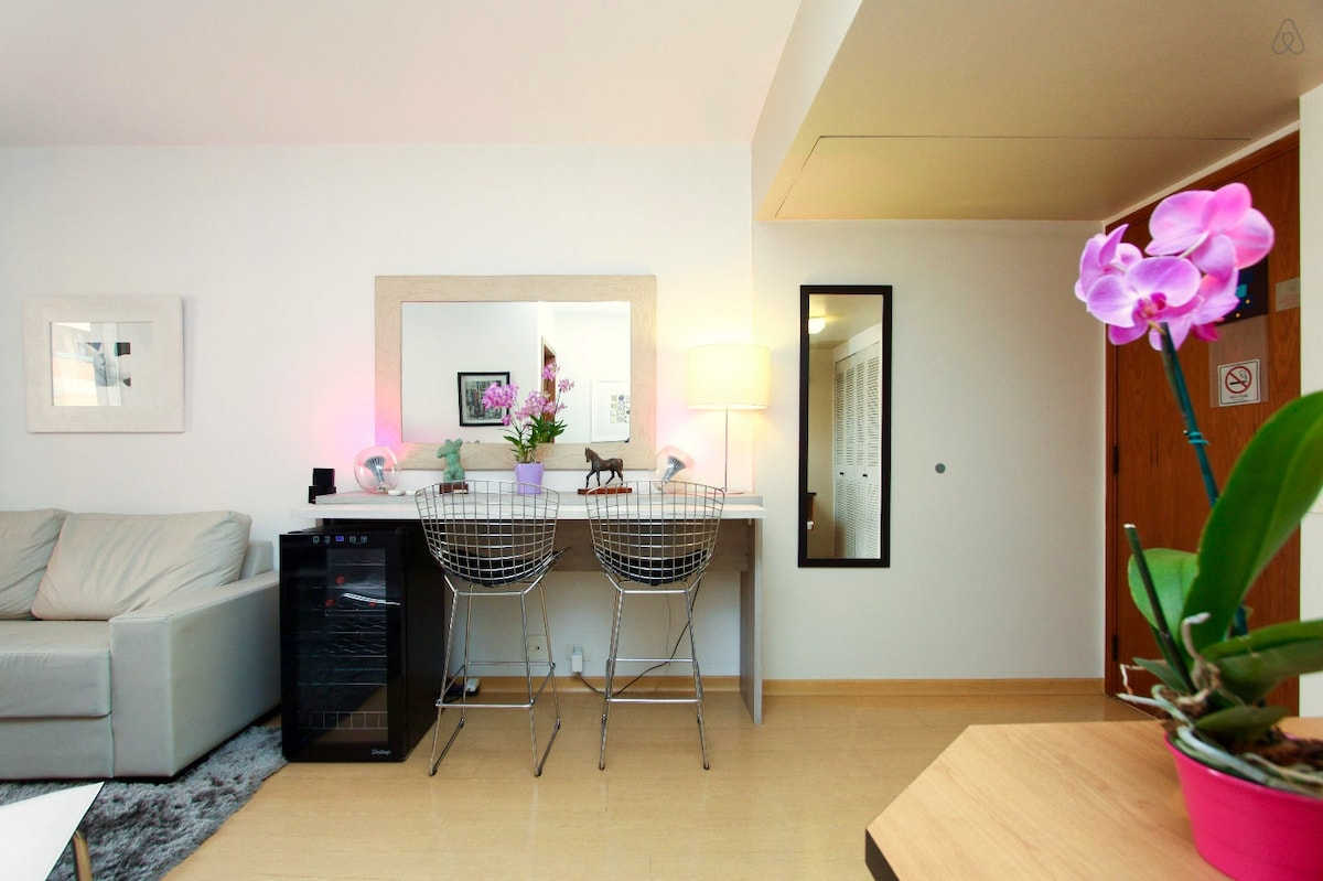 Dinning table and apartment entrance (on the right)