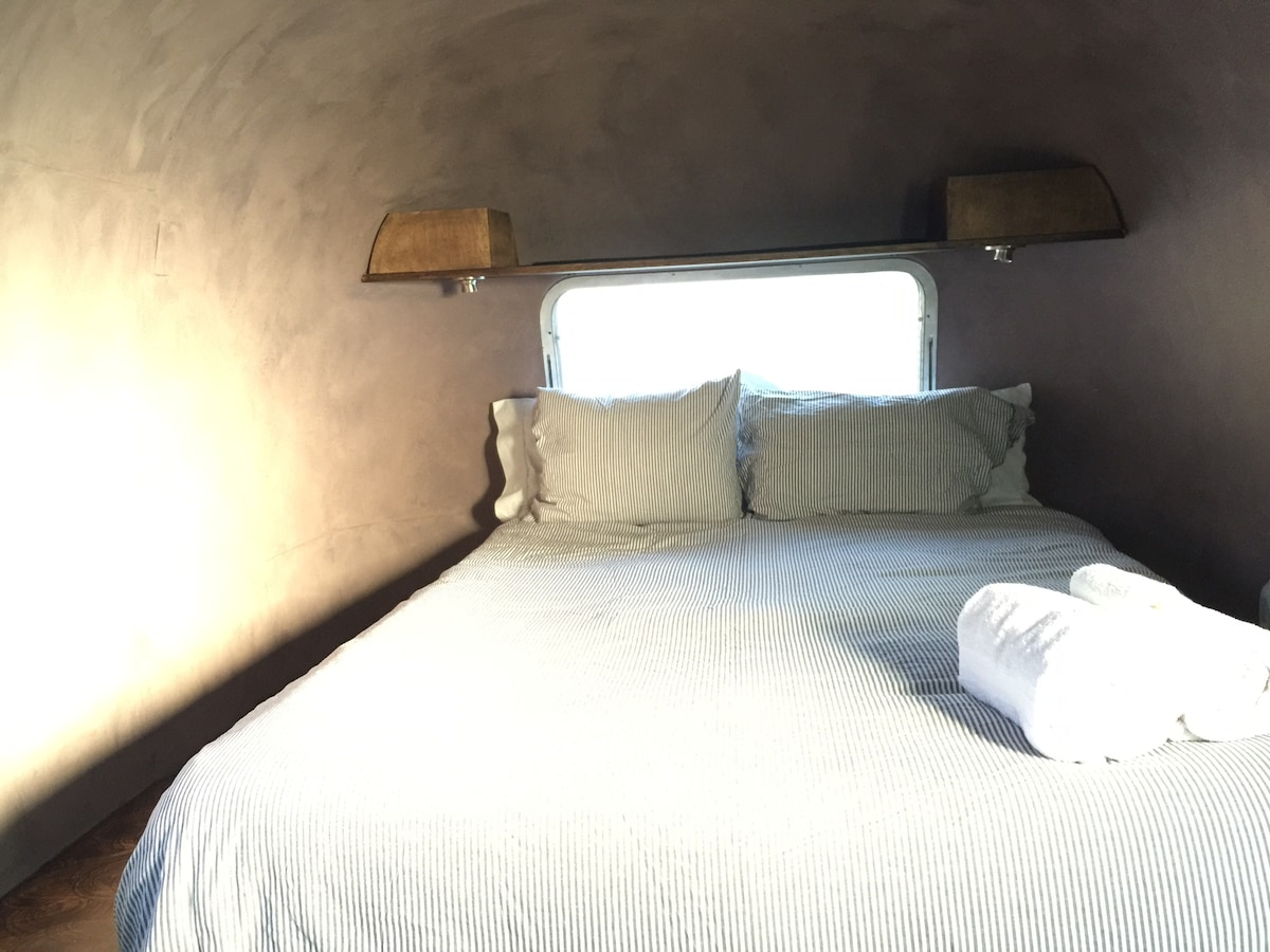 queen size tempurpedic bed in the back of the airstream is quiet and cozy