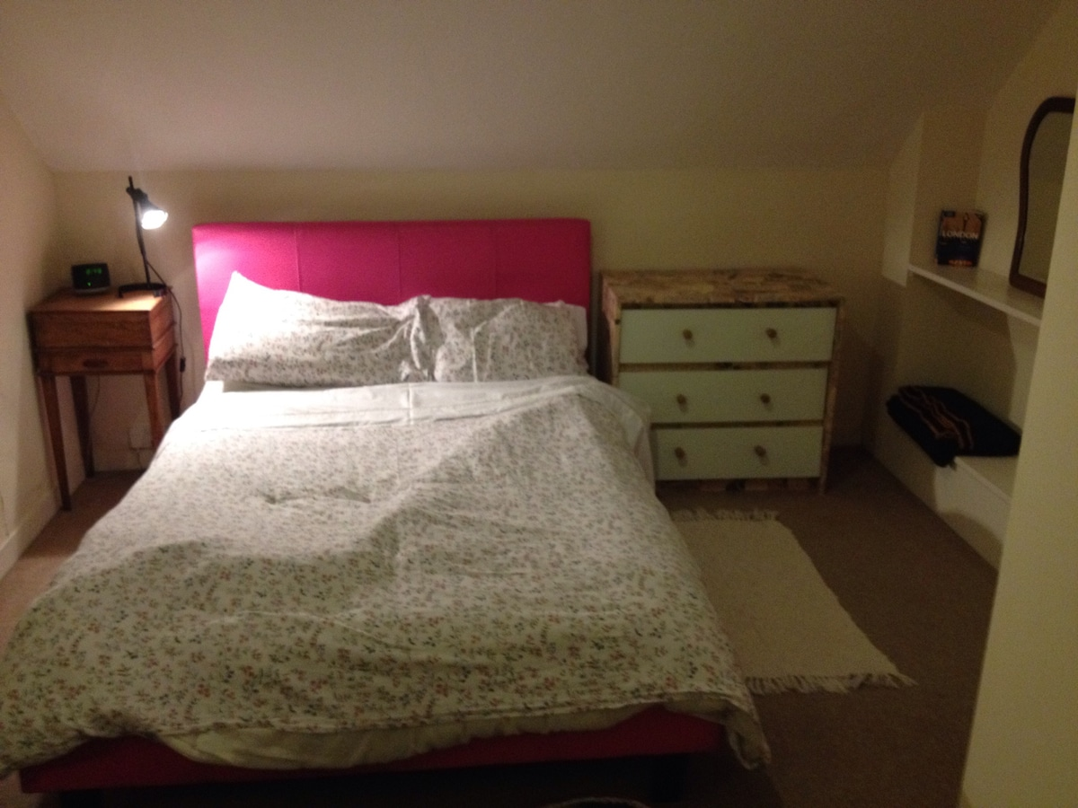 double bed, clothes storage.