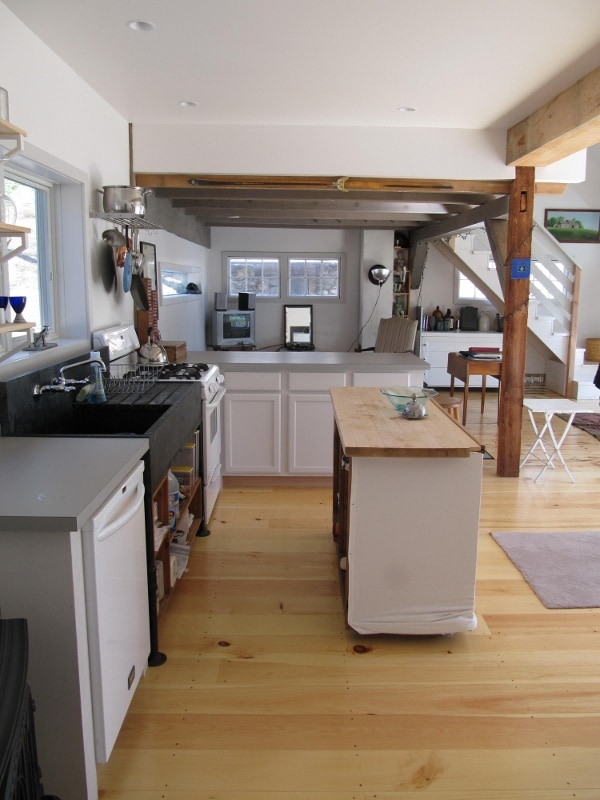 View of kitchen and adjoining living room space.