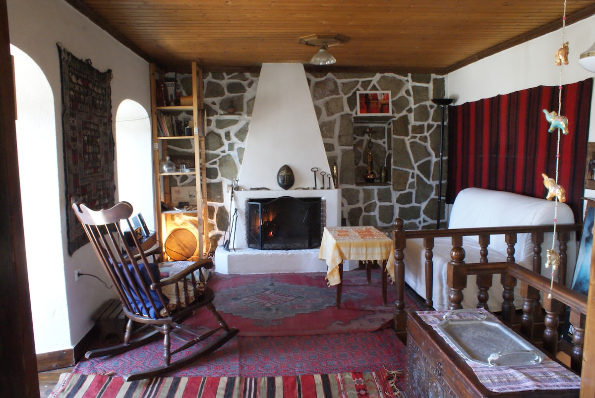 the upstairs living room with fireplace