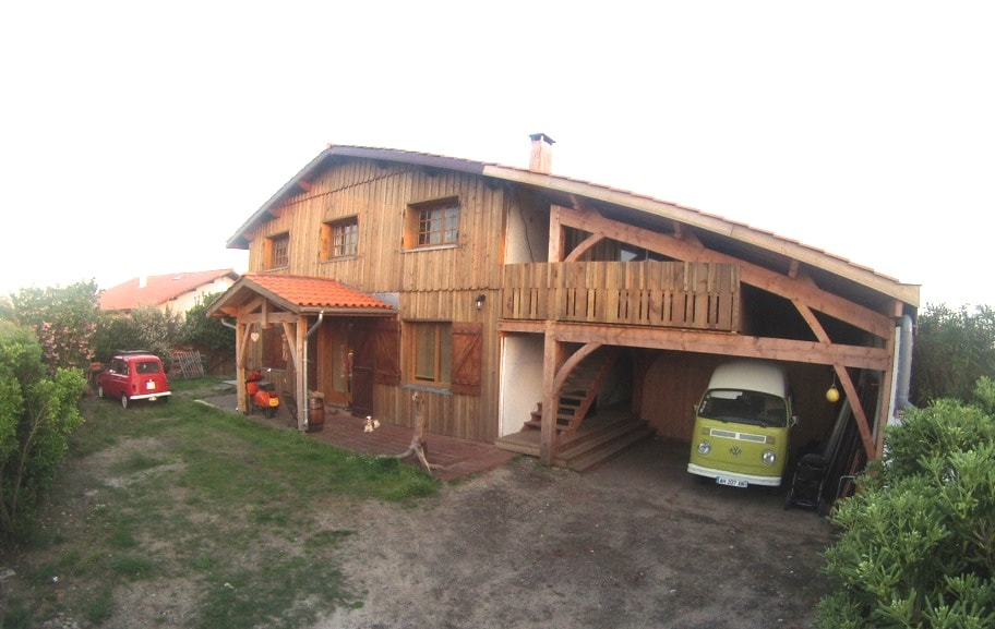 Front of house, car port and loft balcony. Apptm is upstairs.