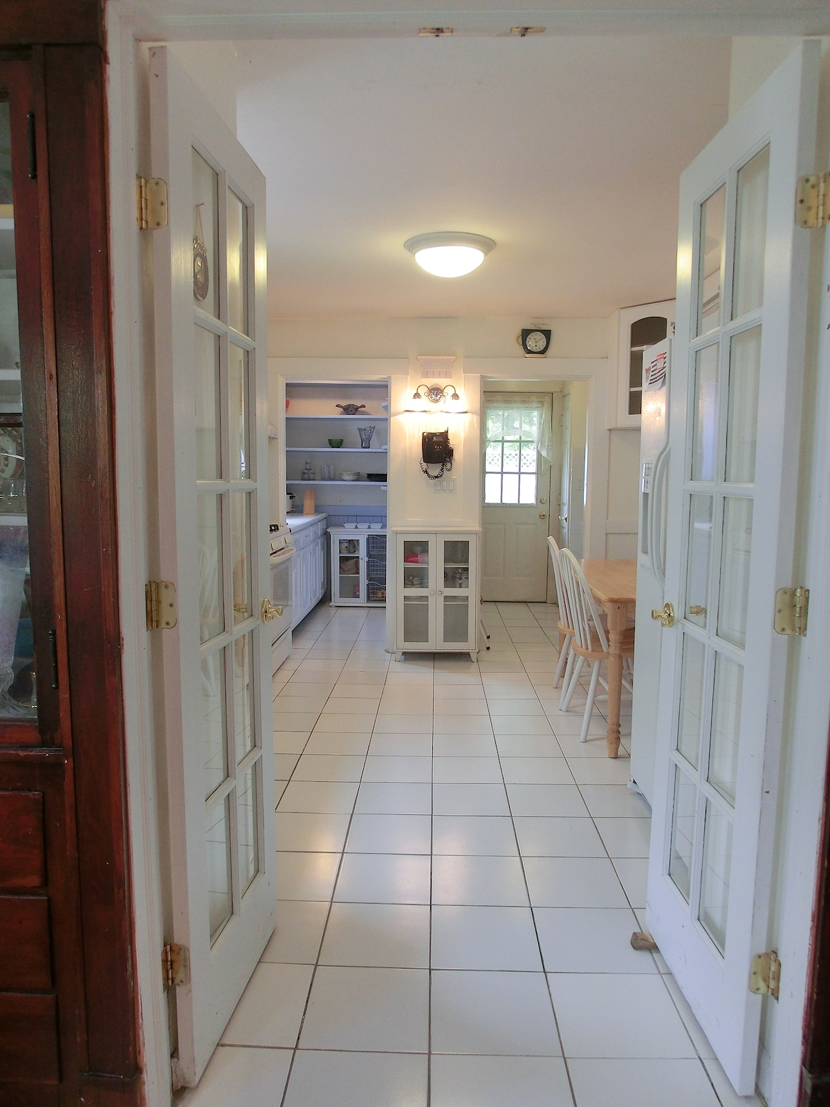 Kitchen has back door leading to nice backyard.