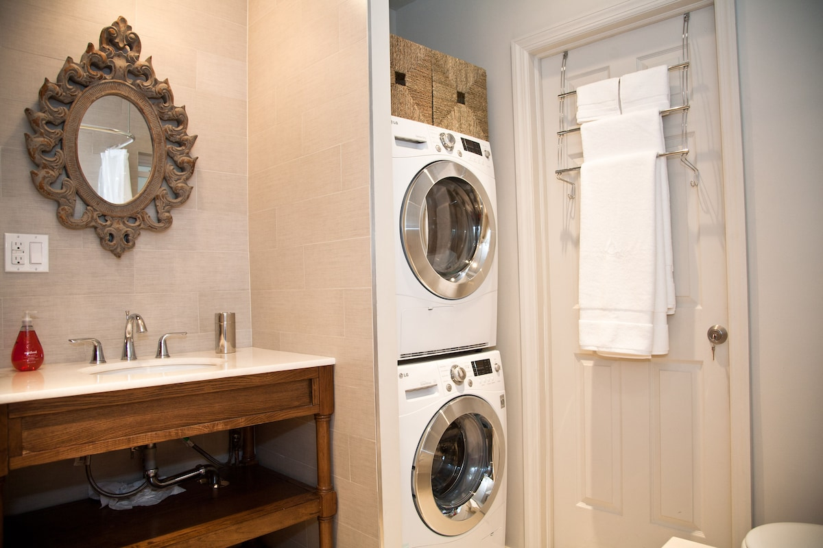 Electric washer and dryer - great for small loads.  Towels provided.
