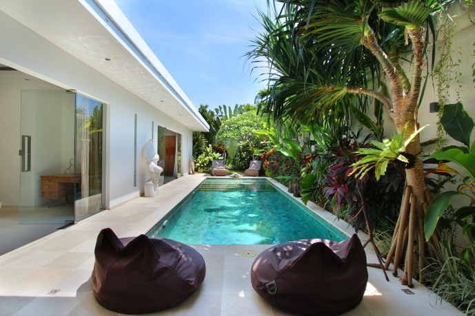 Pool view with comfy bean bags.