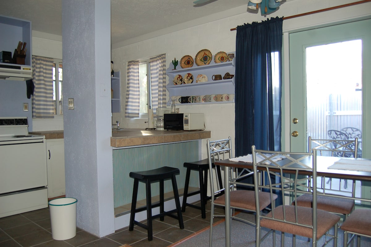 Kitchen and dining area with a view of the private patio