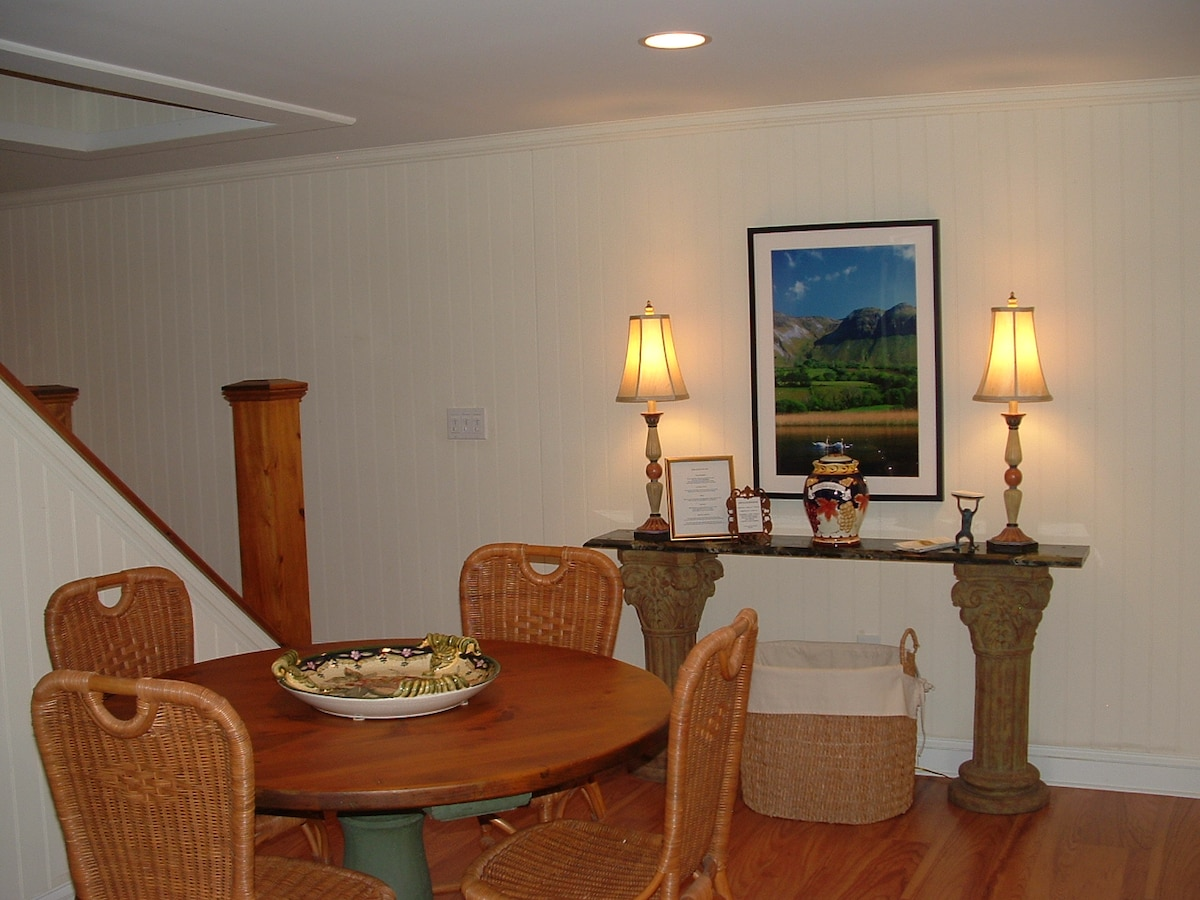 A table to dine at or game at.  Beyond leads to the micro and coffee maker alcove.