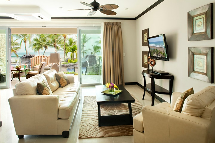 Living room with ocean and pool view