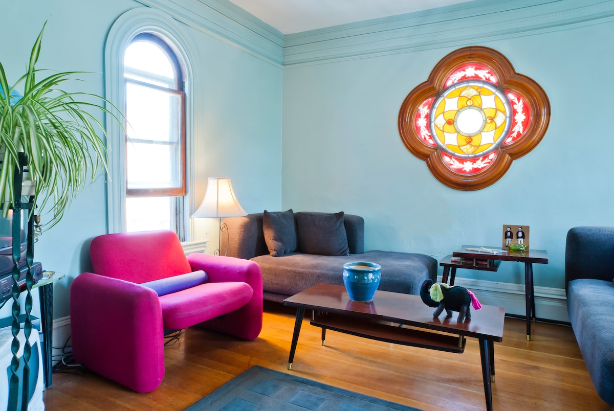 Living room with the grand stained glass window
