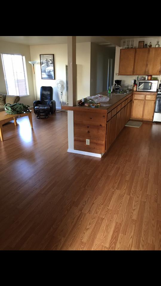 New floor in the living/room along with other improvements.