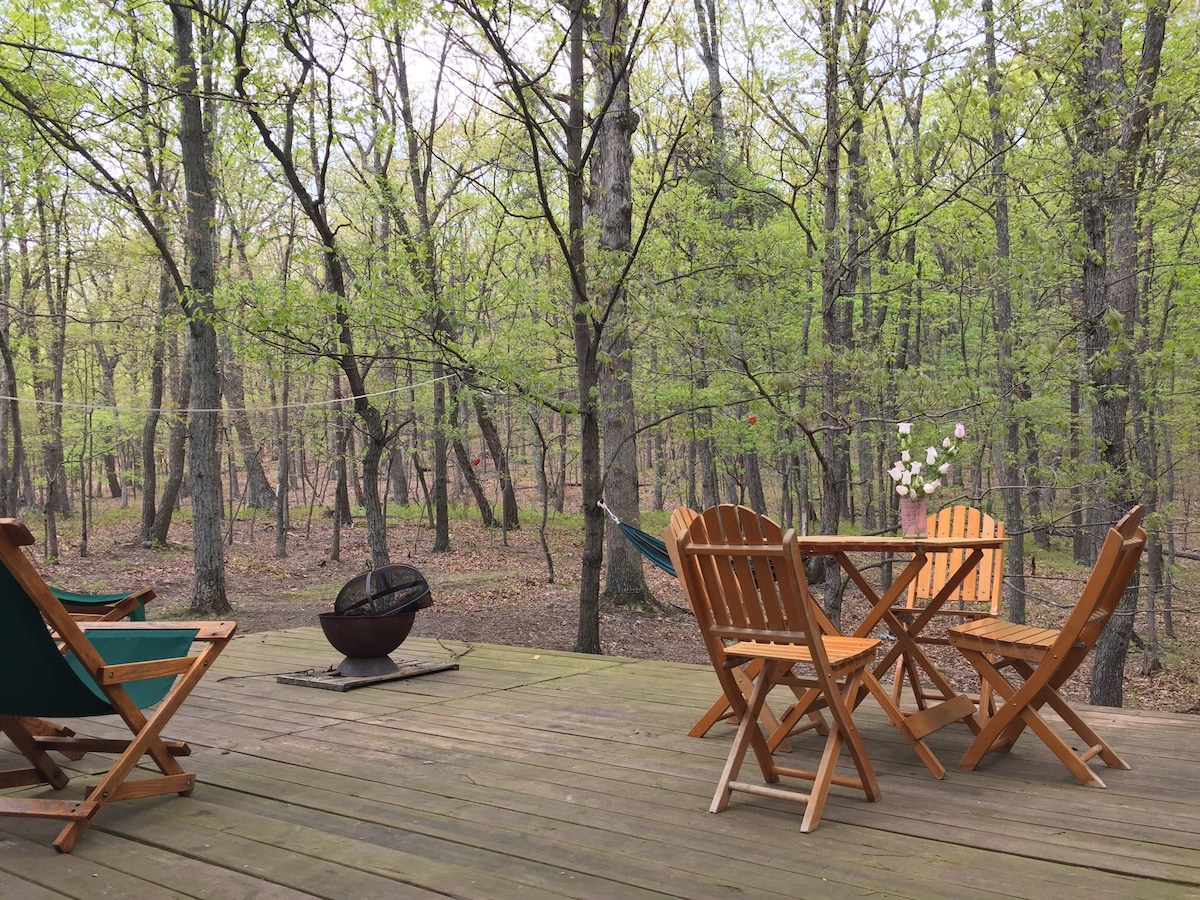 Early spring brings brilliant greens and chatty woodpeckers to deck loungers.