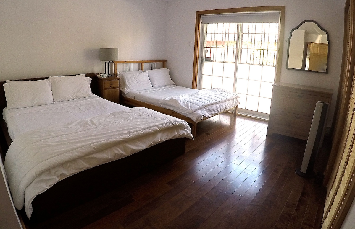 Queen bed and Double bed with balcony. Lots of natural light