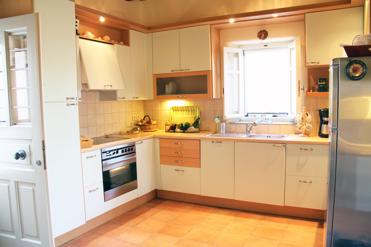 The kitchen is spacious and fully equipped