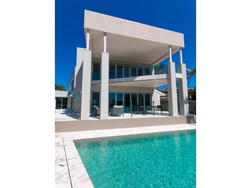 Large modern mansion on waterfront with pool