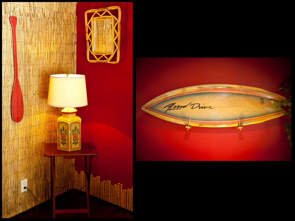 Vintage surfboard and bamboo walls
