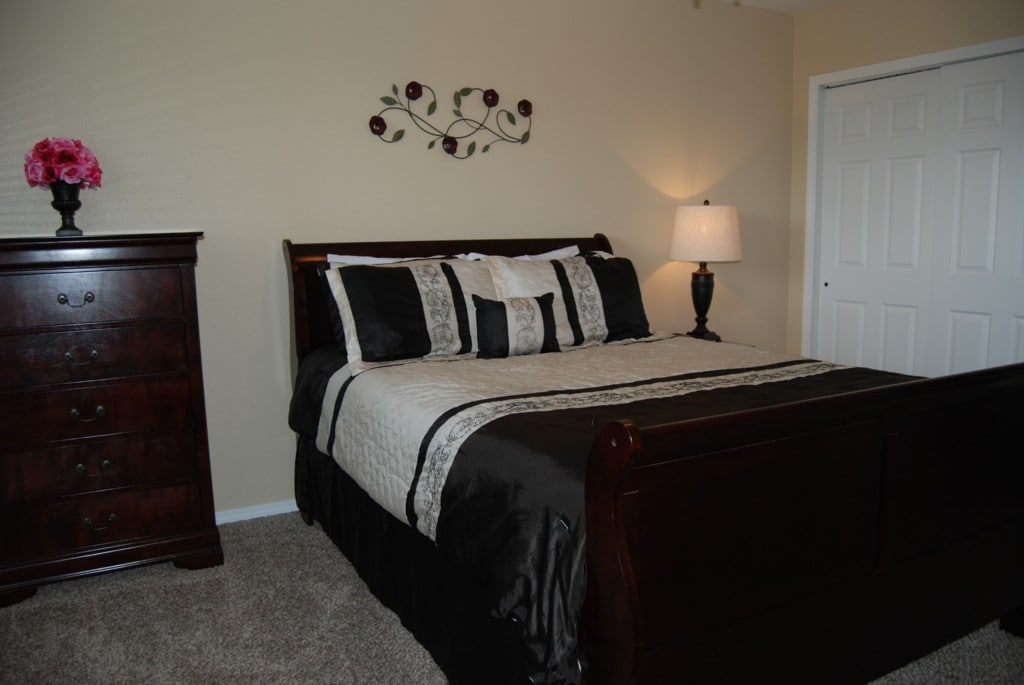 Master bedroom has a queen bed and private bathroom