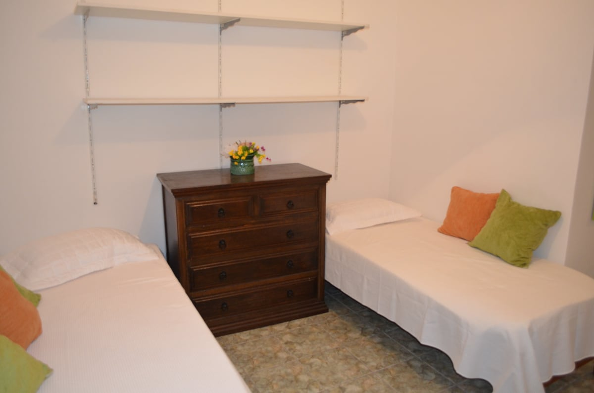 One couple's bed , one single bed, wardrobe, shelves
