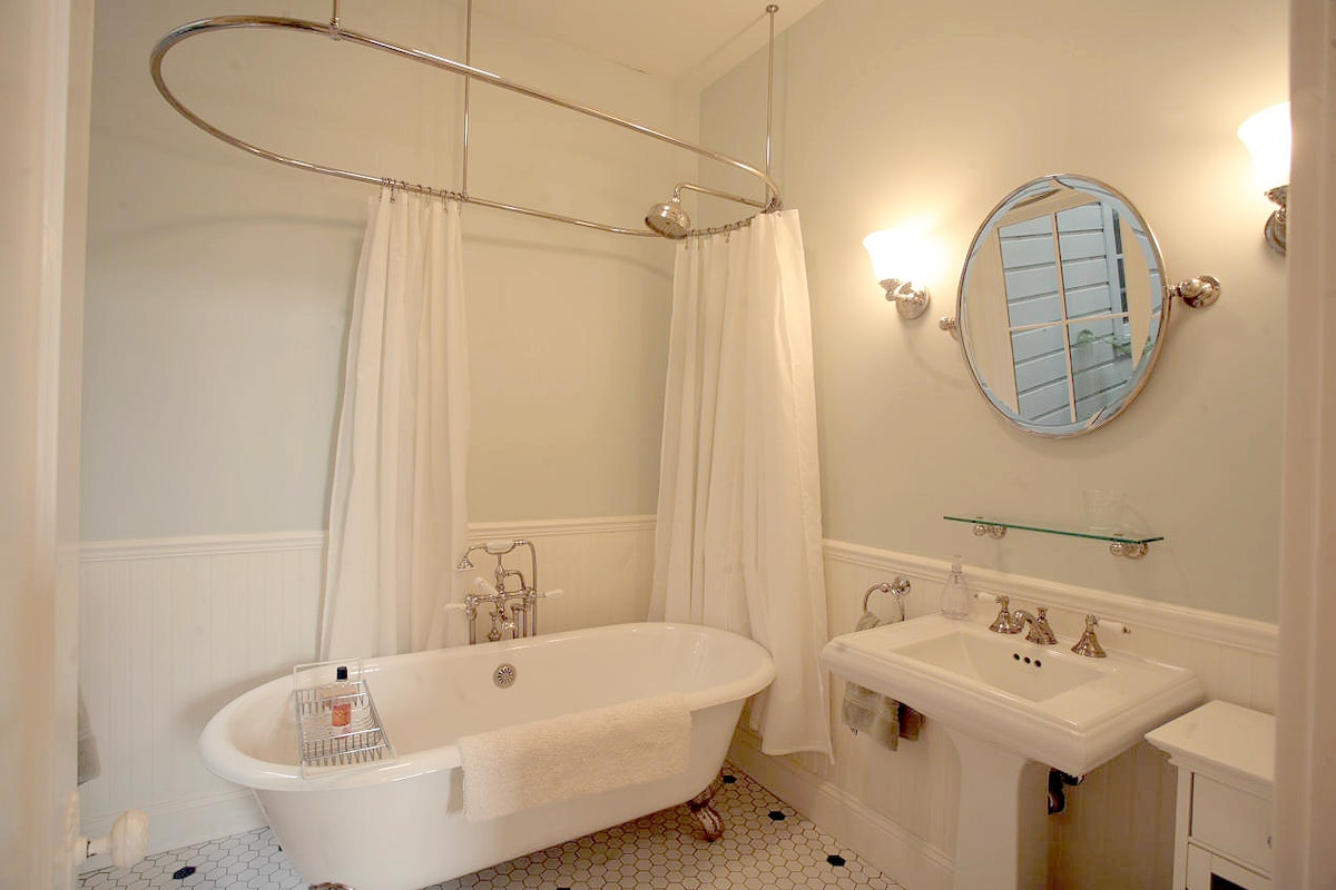"Your private bathroom has a large claw foot tub, with a ""rain"" shower head."