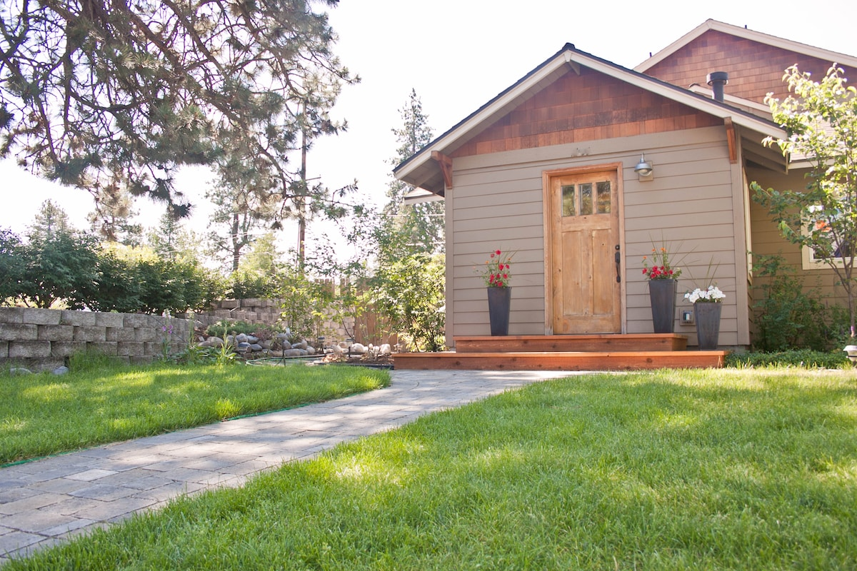 Cute Craftsman home with lush garden and shaded sitting area for your evening micro brew