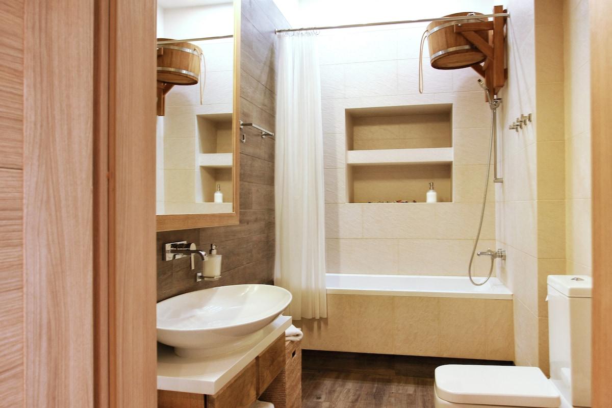 Huge sink, heated floors and a Russian bucket in the bathroom