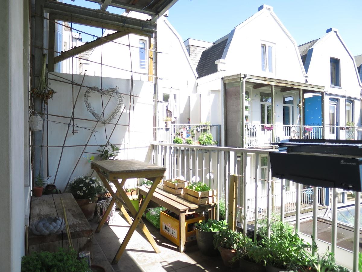 Green balcony in vibrant De Pijp