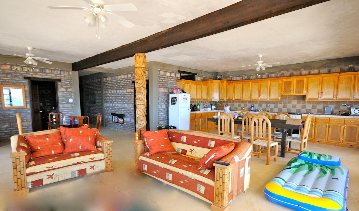 Living/dining area includes two sofas, an easy chair, a modern kitchen...