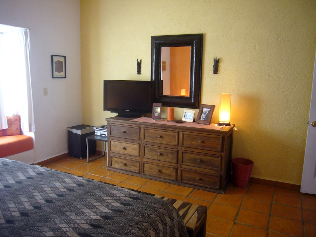 Master Bedroom with Large Flat Screen TV and DVD Collection of over 200 movies