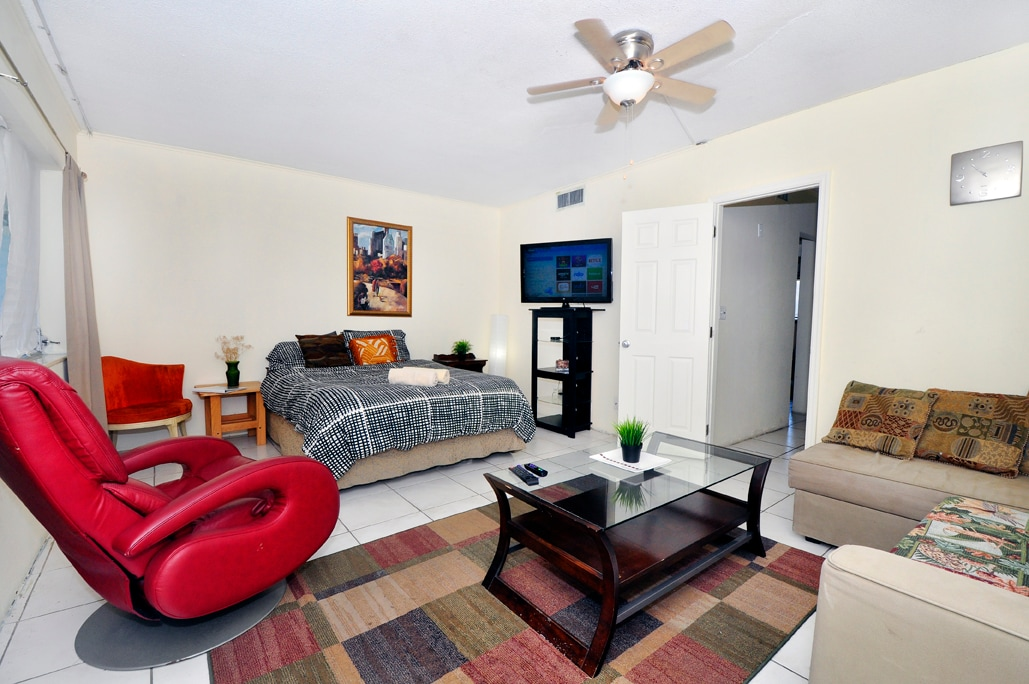 Second large room with living room (enclosed wall). 1 Queen Bed, 1 additional Twin Mattress. Movie Recliner. Flat Screen TV