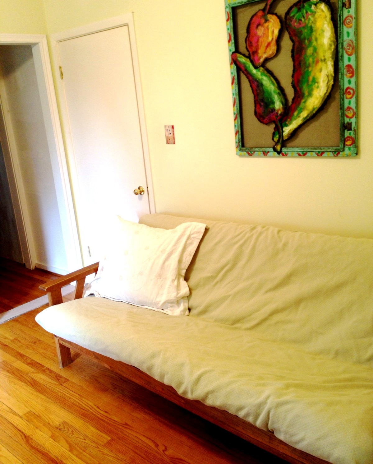 excellent sleeping futon, solid slatted wood base with no bumps and no metal rickety rack