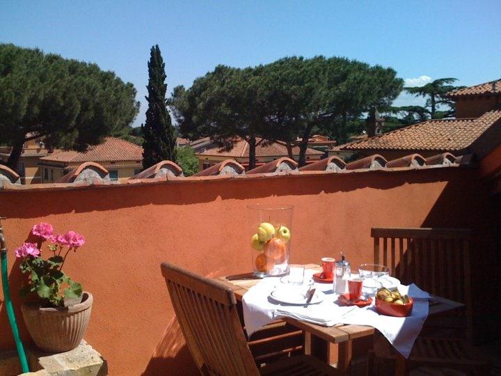 enjoy breakfast overlooking the roofs