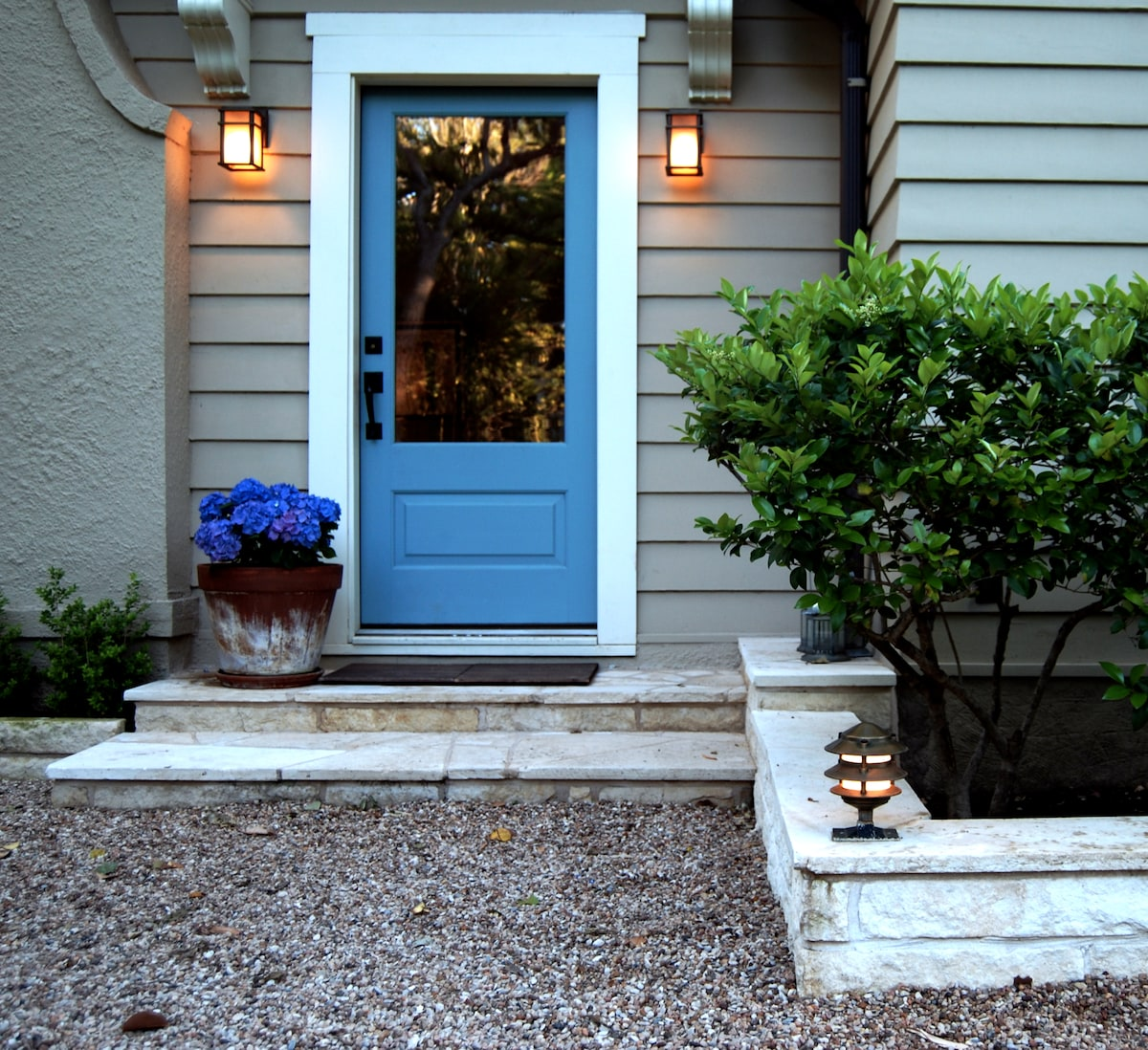 Inviting front entry with addition outdoor seating area (not pictured)