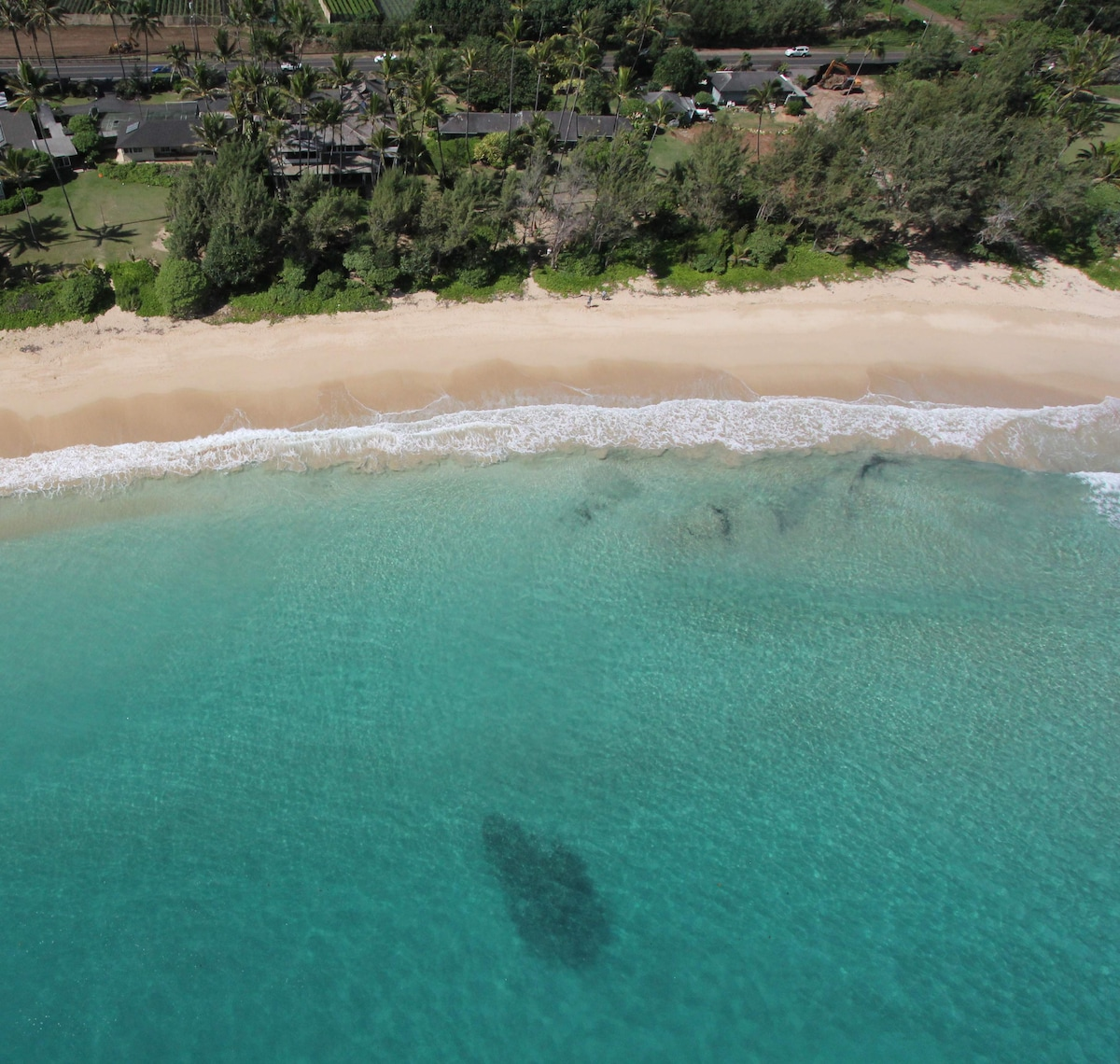 Aerial view showing sandy beach great for kids/swimming.