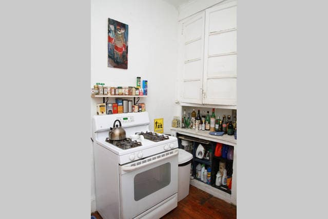 The kitchen includes a modern gas-burning stove and oven, and all the necessary cookware and utensils...