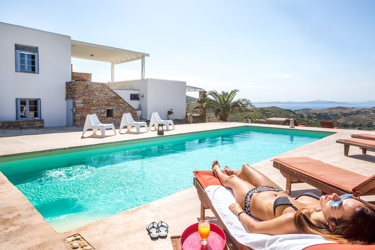 Relax & enjoy your drink by the pool Pool sitting area by the pool. The pool is shared with villa Thea house. If you wish to have full privacy you can book both houses