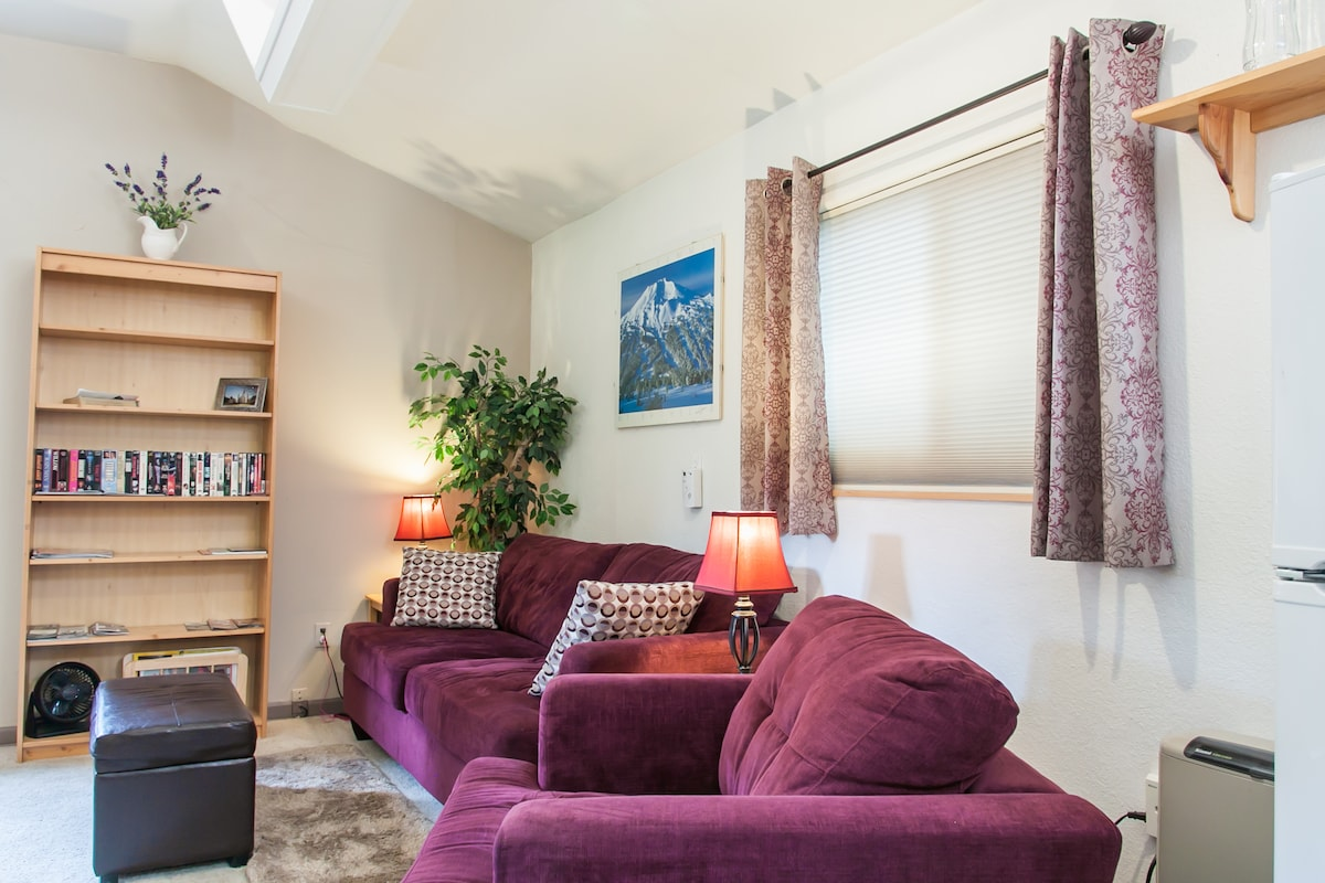 Tastefully decorated living space. Close the blinds and drapes for ultimate privacy.