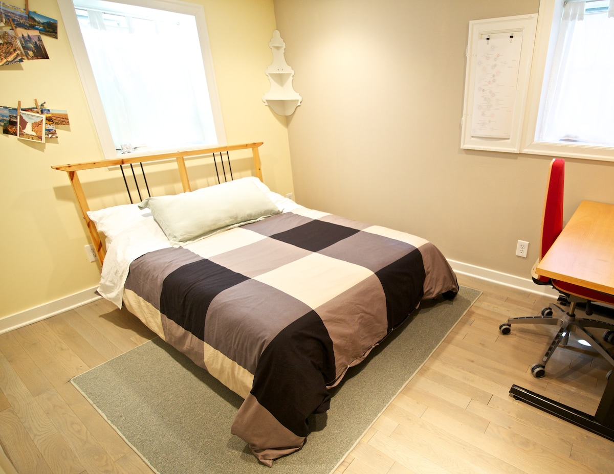Your room, with full-size bed.