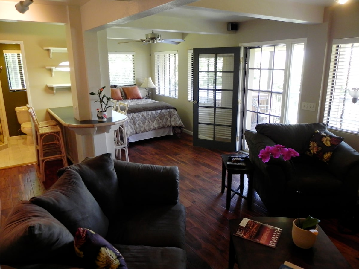 a clean, spacious apartment that opens to a private deck with a hot tub!
