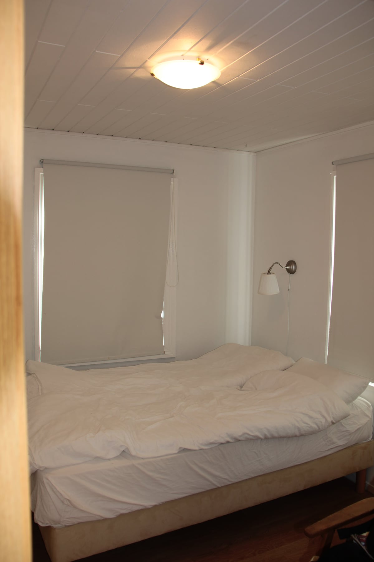 This bedroom has a small double bed.