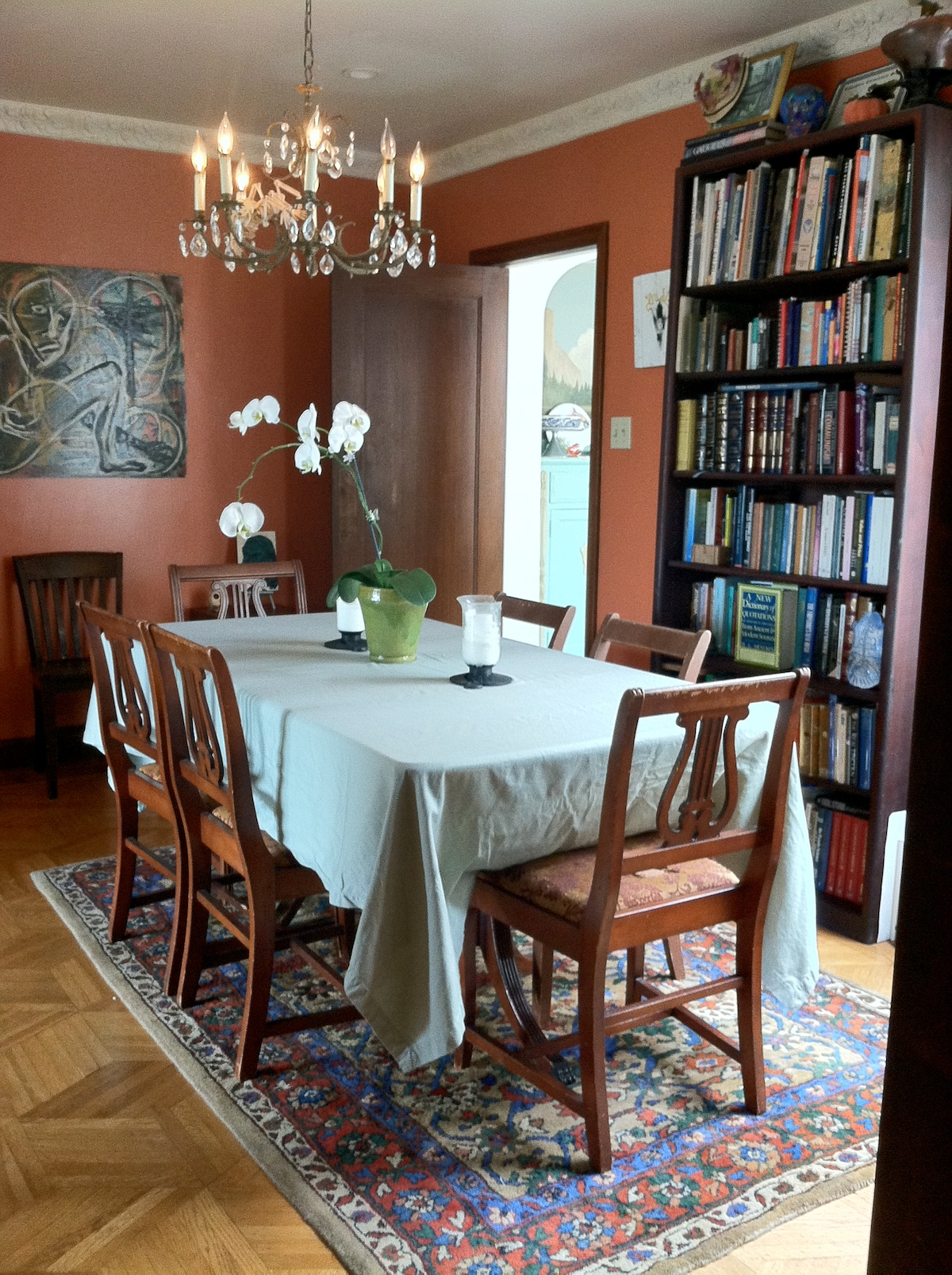 The dining room doubles as the library with an extensive selection of titles ranging from Ayn Rand to Madame Blavatsky and beyond.