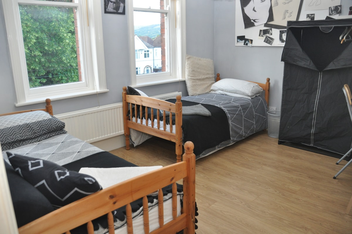 Creative bedroom with 2 single beds