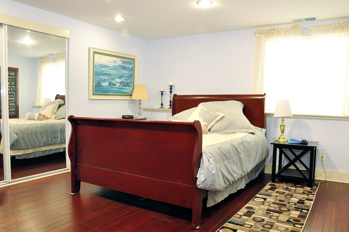 Large queen size bed in large bedroom