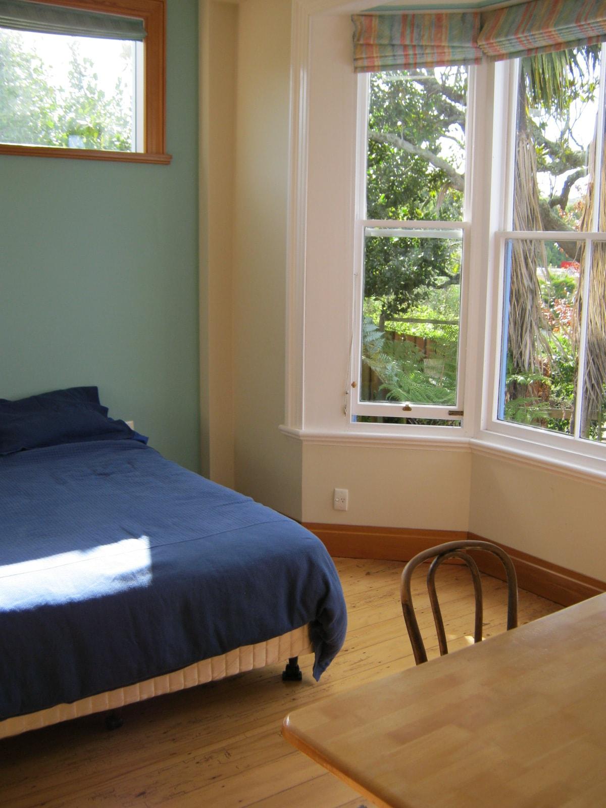 Queen bed, bay window looking out over garden