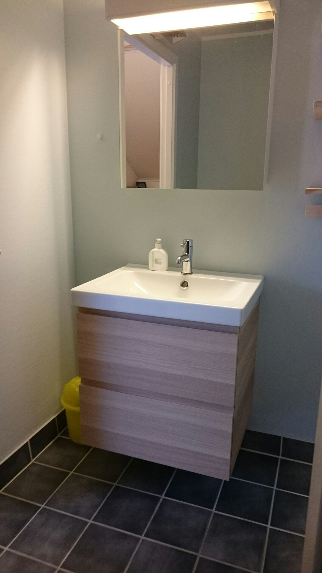 The bathroom contains a wash and mirror, a shower cabinet and a toilet. The sink and drawers are new (summer 2015), and the bathroom walls were also painted to give the bathroom a mini-makeover.