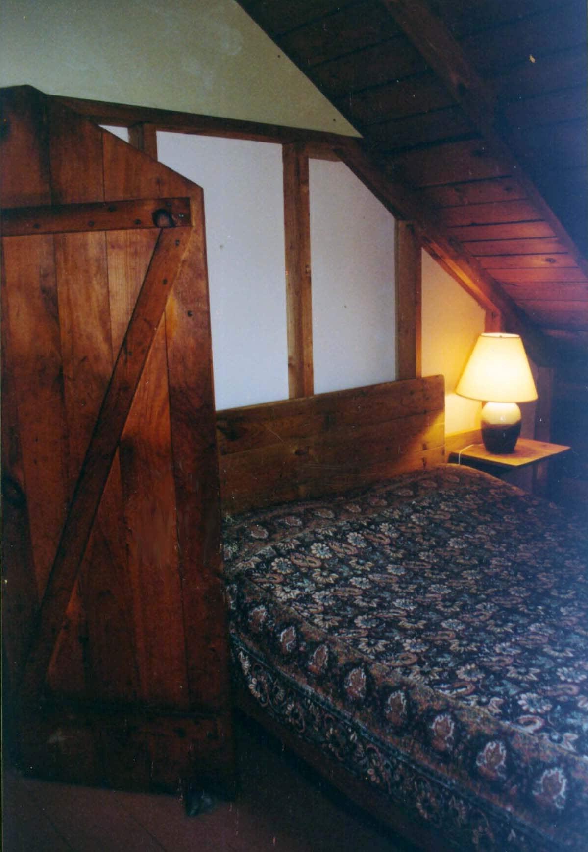 One of two upstairs bedrooms with a double bed each