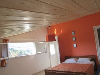 Top floor double bedroom with panoramic window over the beautiful green valley below