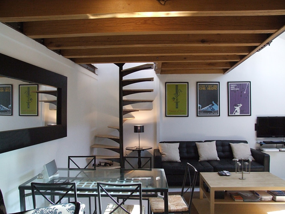 Living room with staircase to mezzanine and roof terrace